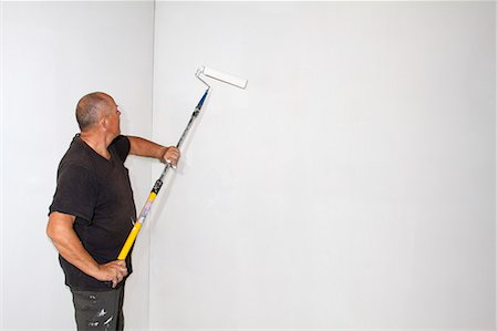 painting - Studio shot of senior roller painting room walls Stock Photo - Premium Royalty-Free, Code: 649-07280913