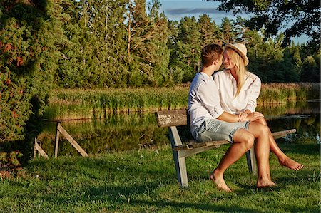 Romantic young couple on park bench, Gavle, Sweden Stock Photo - Premium Royalty-Free, Code: 649-07280967
