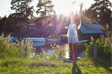 Young woman dancing next to lake, Gavle, Sweden Stock Photo - Premium Royalty-Free, Code: 649-07280975