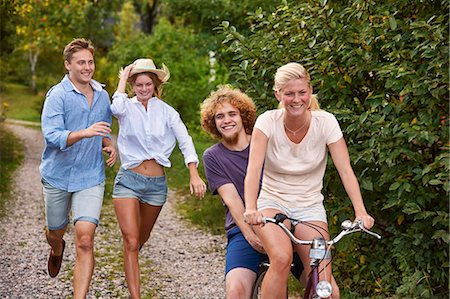 Two young couples chasing each other on bicycle, Gavle, Sweden Stock Photo - Premium Royalty-Free, Code: 649-07280970