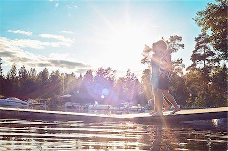 Two young adult men walking along pier, Gavle, Sweden Stock Photo - Premium Royalty-Free, Code: 649-07280972