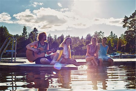people and vacation - Two young couples relaxing on pier, Gavle, Sweden Stock Photo - Premium Royalty-Free, Code: 649-07280981
