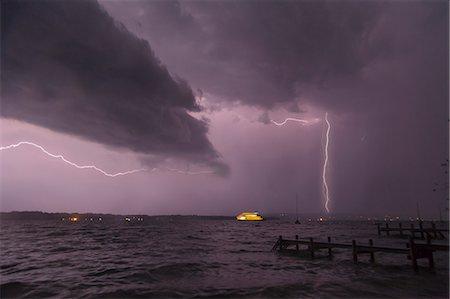 View of storm and lightning on Lake Starnberg, Bavaria, Germany Stock Photo - Premium Royalty-Free, Code: 649-07280998
