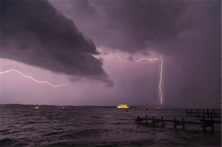 View of storm and lightning on Lake Starnberg, Bavaria, Germany Stock Photo - Premium Royalty-Free, Code: 649-07280998