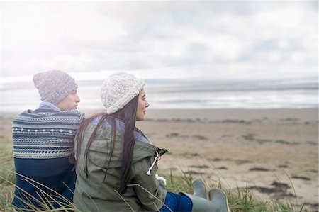 sweater - Young couple sitting on beach, Brean Sands, Somerset, England Stock Photo - Premium Royalty-Free, Code: 649-07281034