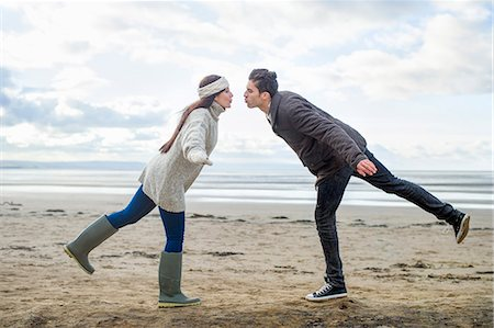Young couple on one leg, Brean Sands, Somerset, England Stock Photo - Premium Royalty-Free, Code: 649-07281037
