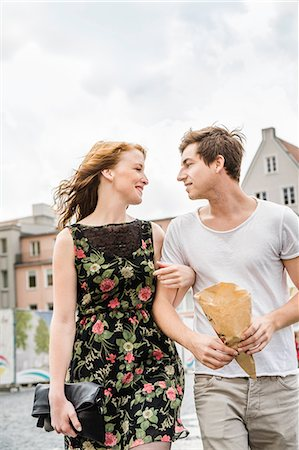Young couple walking through town arm in arm Stock Photo - Premium Royalty-Free, Code: 649-07436295
