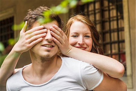 surprised - Young woman covering boyfriend's eyes Stock Photo - Premium Royalty-Free, Code: 649-07436305