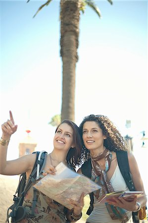 Young women looking at map and pointing Stock Photo - Premium Royalty-Free, Code: 649-07436323
