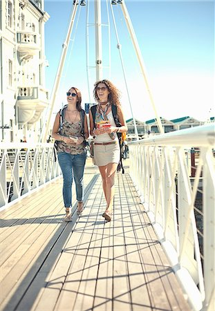 Young women walking along pier, Cape Town, South Africa Stock Photo - Premium Royalty-Free, Code: 649-07436330