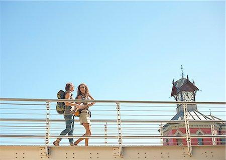 Young women walking across bridge Stock Photo - Premium Royalty-Free, Code: 649-07436332