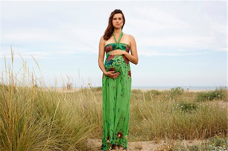 Pregnant woman standing in field Stock Photo - Premium Royalty-Free, Code: 649-07436425