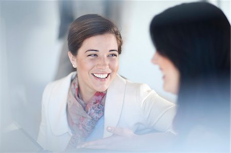 Businesswomen having conversation Stock Photo - Premium Royalty-Free, Code: 649-07436529