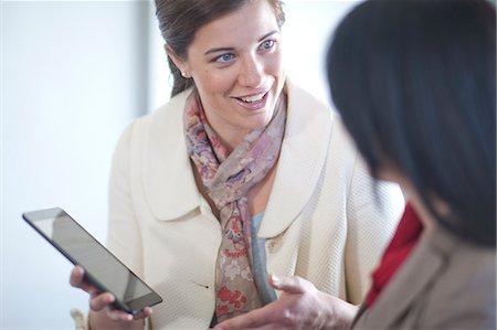 relationship - Businesswomen using digital tablet Stock Photo - Premium Royalty-Free, Code: 649-07436530