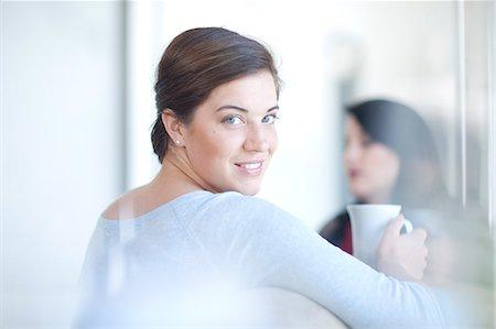 partnership - Businesswoman holding cup of tea Stock Photo - Premium Royalty-Free, Code: 649-07436531
