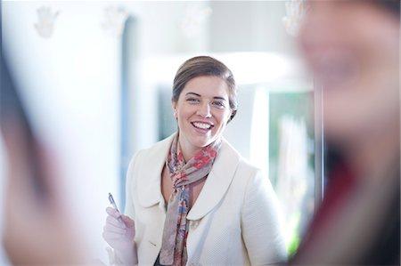 partnership - Businesswoman standing in office Stock Photo - Premium Royalty-Free, Code: 649-07436533