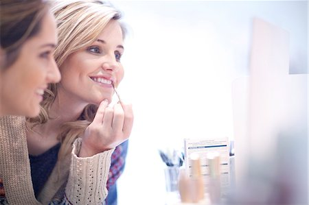 Young women applying make up Stock Photo - Premium Royalty-Free, Code: 649-07436558