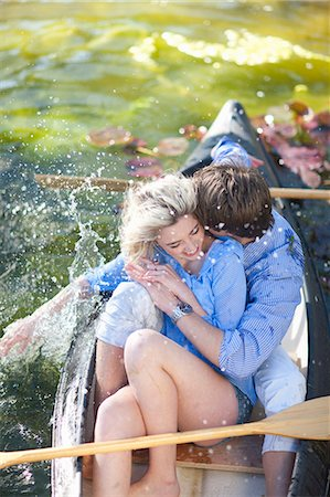 Young romantic couple fooling around in rowing boat Stock Photo - Premium Royalty-Free, Code: 649-07436560