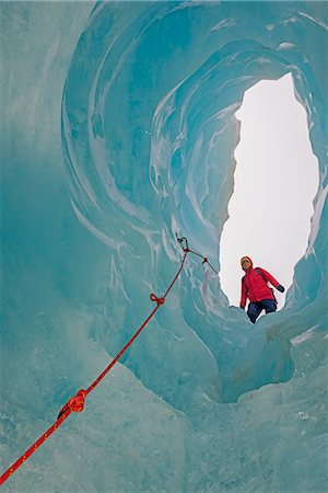 Ice climber looking down ice cave Fox Glacier, South Island, New Zealand Stock Photo - Premium Royalty-Free, Code: 649-07436617