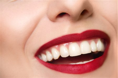 Cropped studio portrait of young woman's smiling mouth Stock Photo - Premium Royalty-Free, Code: 649-07436638