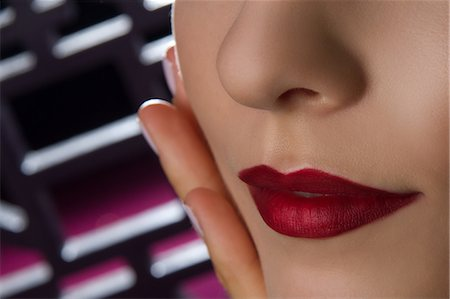 Close up studio portrait of young woman's lips Stock Photo - Premium Royalty-Free, Code: 649-07436631