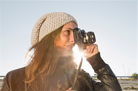 Portrait of young woman using slr camera Stock Photo - Premium Royalty-Free, Code: 649-07436669