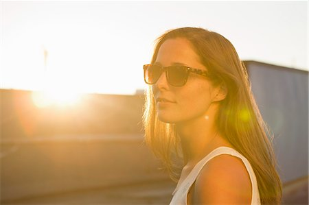 sun - Portrait of young woman wearing sunglasses Stock Photo - Premium Royalty-Free, Code: 649-07436677