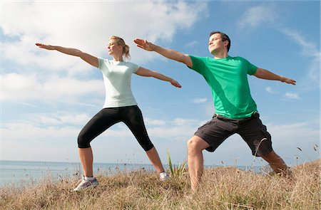 fit people - Mid adult couple exercising on cliff top, Thurlestone, Devon, UK Stock Photo - Premium Royalty-Free, Code: 649-07436706
