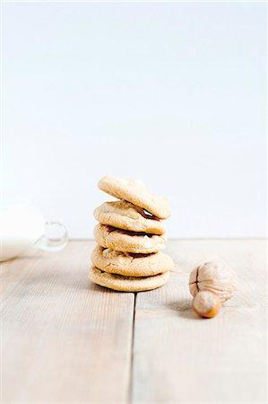 Stacked of hazelnut cookies and hazelnuts Stock Photo - Premium Royalty-Free, Code: 649-07436723