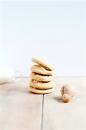 Stacked of hazelnut cookies and hazelnuts Stock Photo - Premium Royalty-Free, Code: 649-07436723