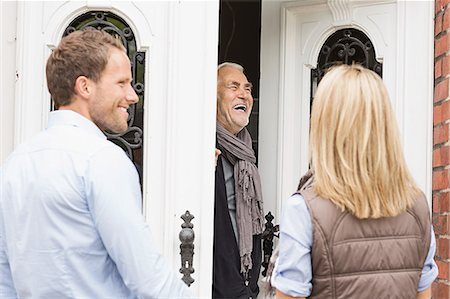 Father opening front door laughing Stock Photo - Premium Royalty-Free, Code: 649-07436798