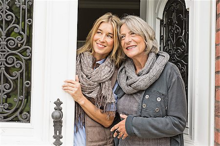 Mother and daughter by front door Stock Photo - Premium Royalty-Free, Code: 649-07436811
