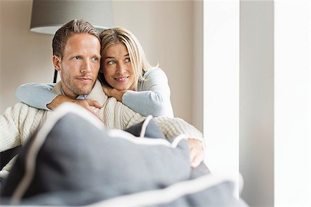 Portrait of mid adult couple looking away Stock Photo - Premium Royalty-Free, Code: 649-07436836