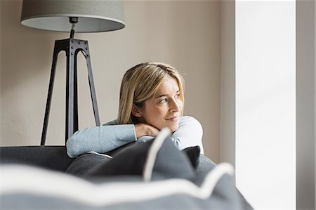 Portrait of mid adult woman looking away Stock Photo - Premium Royalty-Free, Code: 649-07436837