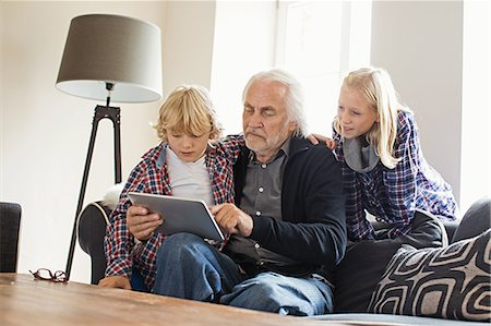 preteens pictures older men - Grandfather using digital tablet with grandchildren Stock Photo - Premium Royalty-Free, Code: 649-07436833