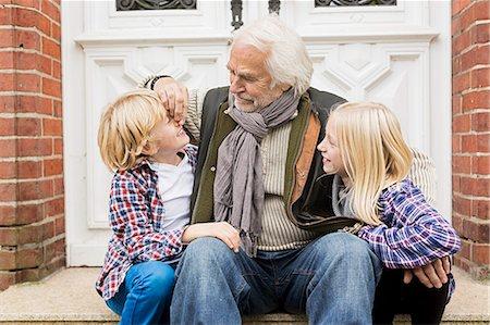 preteens pictures older men - Grandfather sitting with grandchildren on front doorstep Stock Photo - Premium Royalty-Free, Code: 649-07436844