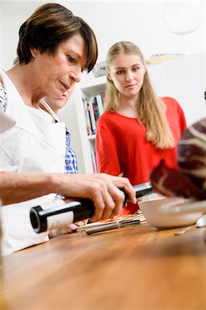 Mother and daughters preparing food Stock Photo - Premium Royalty-Free, Code: 649-07436925
