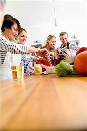 Mother, daughters and son preparing food Stock Photo - Premium Royalty-Free, Code: 649-07436927