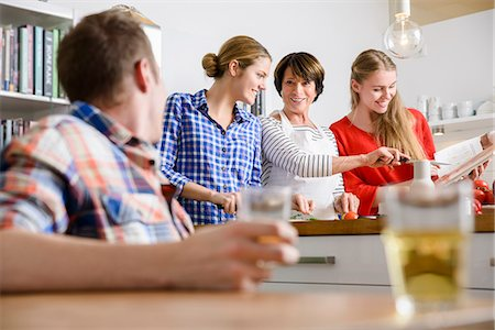Mother, daughters and son preparing food in kitchen Stock Photo - Premium Royalty-Free, Code: 649-07436931