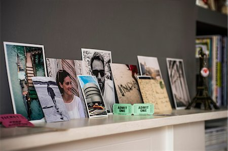 Living room mantelpiece with travel souvenirs and photographs Stock Photo - Premium Royalty-Free, Code: 649-07437028
