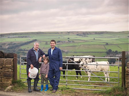 farming (raising livestock) - Mature farmer, adult son and grandson standing together at gate to cow field, portrait Stock Photo - Premium Royalty-Free, Code: 649-07437076