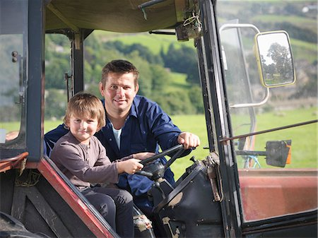 farm and boys - Farmer and young son in tractor in field, portrait Stock Photo - Premium Royalty-Free, Code: 649-07437071