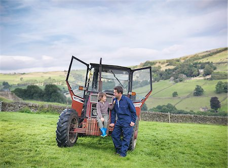 Farmer and young son sitting on tractor in field Stock Photo - Premium Royalty-Free, Code: 649-07437073