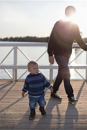 Toddler and father by lake Stock Photo - Premium Royalty-Free, Code: 649-07437107