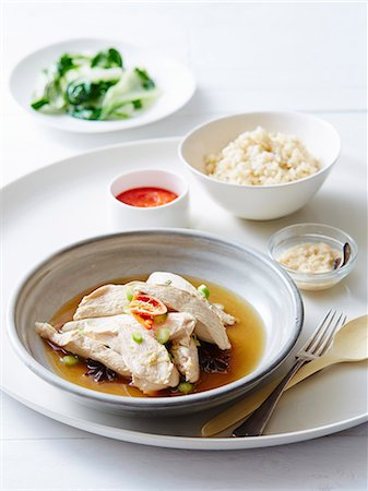 delicious - Still life of hainan chicken with steamed rice Stock Photo - Premium Royalty-Free, Code: 649-07437290