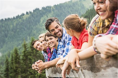 Group of friends leaning on wooden fence, Tirol, Austria Stock Photo - Premium Royalty-Free, Code: 649-07437307