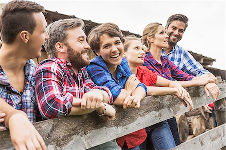 Group of friends leaning on wooden fence, Tirol, Austria Stock Photo - Premium Royalty-Free, Code: 649-07437308