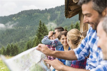 Group of friends chatting and reading map, Tirol, Austria Stock Photo - Premium Royalty-Free, Code: 649-07437315