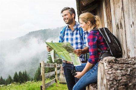 Couple with map embarking on trek, Tirol, Austria Stock Photo - Premium Royalty-Free, Code: 649-07437328