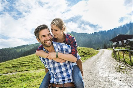 Woman riding piggyback on man, Tirol, Austria Stock Photo - Premium Royalty-Free, Code: 649-07437336